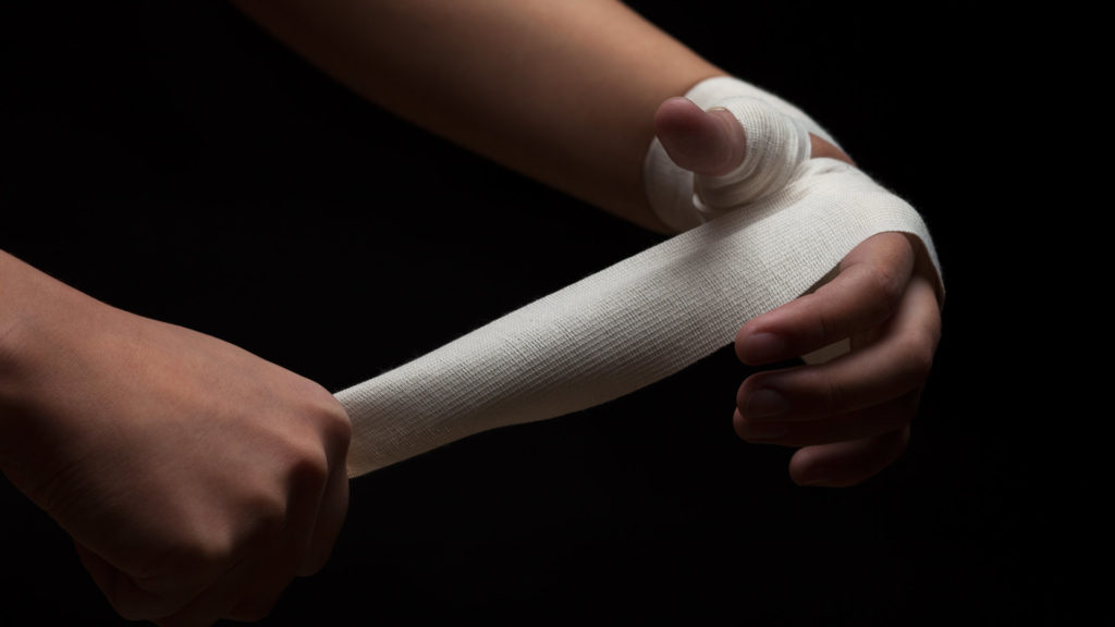Woman hands preparing for self-defence training.