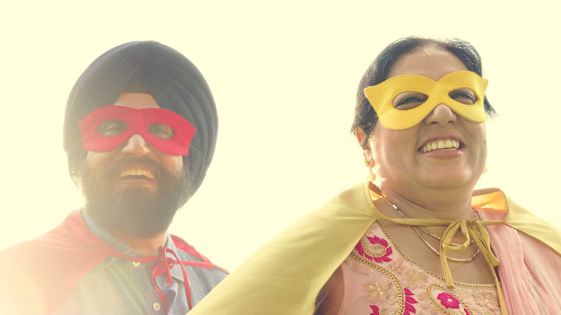 happy and smiling Indian couple wearing superhero masks